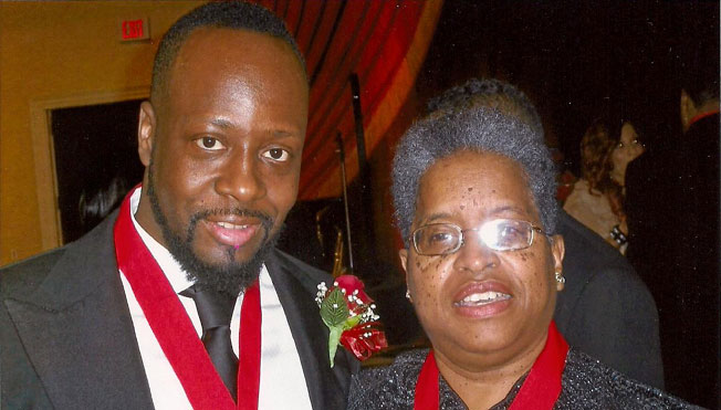 Wyclef Jean — Haitian Musician, Record Producer — Politician with Bishop Dr. Valli [both received AWMF Ribbon and Medallion for Missions work and Support to in 2010].