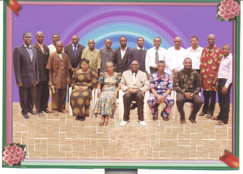 Back row standing left to right: Pastor Emmanuel Okonkwo, Evangelist Obeta Anthony, Pastor Obinna Goodness, Rev. Dr. Sam Olisa DikeEvang. Ifeanyi Agwunobi, Evang. Okwuosa Nnamdi, Pastor Gideon Ihesiaba, Evang. Sam Obeta, Evang. Godwin O. Nelson, Pastor Fillas James Chidozie, Missionary M. C. Ezejiofor, Apostle Benedict Okeke, Pastor Dr. Emeka Nkama. Standing alone amongst the members seated: Pastor Peter Eze. Front row seated: Rev. [Mrs.] Chinwe Odikpo, Rev [Mrs.] Nkem Igwagu, The Coordinator — Apostle Berty Agbanusi, Rev. Chuks Okoro and Evang. Akachukwu Okoye. MINISTERS SOLM ONITSHA OFFICE, Nigeria, West Africa.
